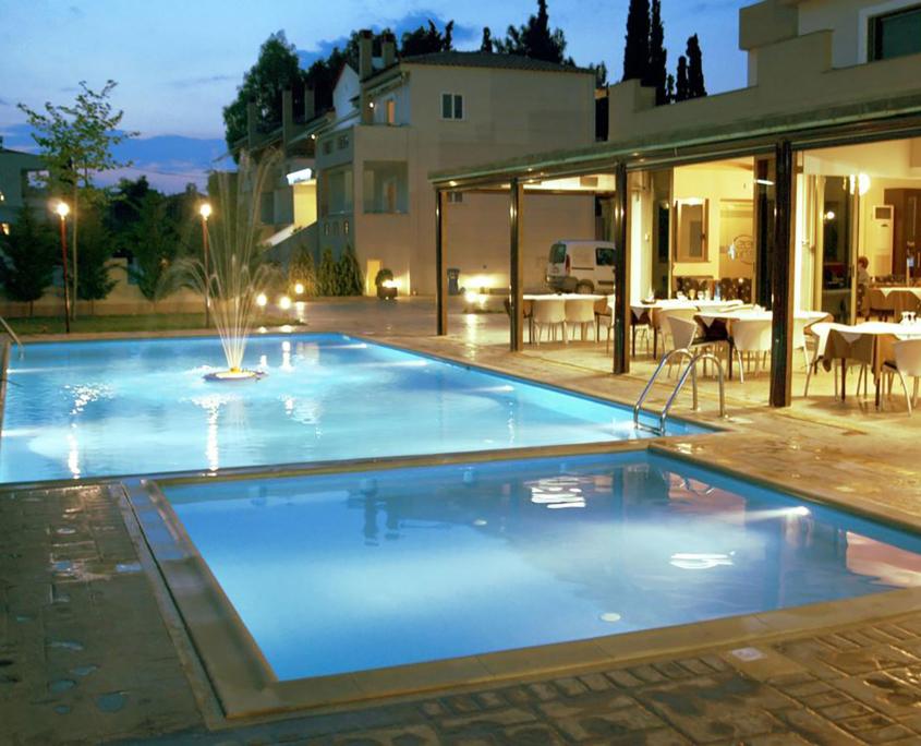 "Exterior Design ""Zeis Edw"" pools at night"