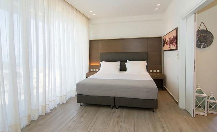 "Interior Design ""Prima Vista Hotel"" bedroom with king bed"